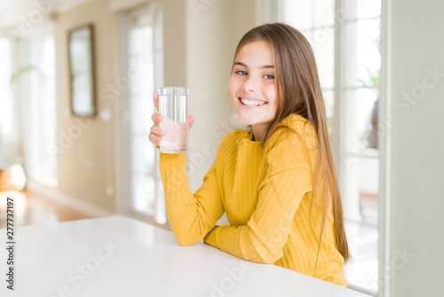 Fotografia, Obraz Beautiful young girl kid drinking a fresh glass of water with a happy face stand