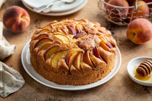 Valokuvatapetti peach cake  on wooden table