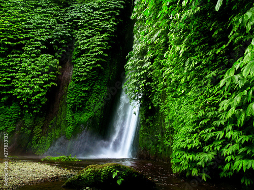 Canvas Print munduk waterfall in the middle of the rainforest in bali-indonesia