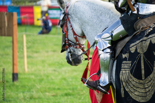 Stampa su Tela A medieval knight sitting on a horse wearing shining armour