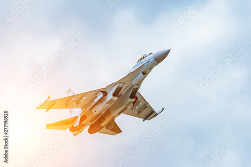 Canvas Print Rapidly taking off combat fighter in the air.