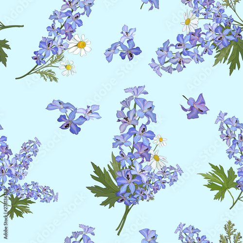 Fotografia Seamless pattern with flowers of delphinium and daisies on a blue background