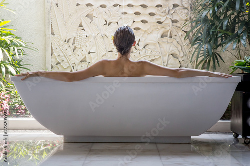 Fotografie, Obraz File name:Portrait of a young woman relaxing in the bathtub, organic skin-care a