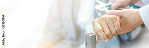 Fotografie, Obraz Elderly female hand holding hand of young caregiver at nursing home