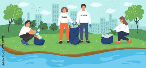 Photo Environmental volunteer activists cleaning riverbank.