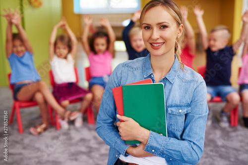 Fotografie, Obraz Portrait of smiling female teacher in the preschool
