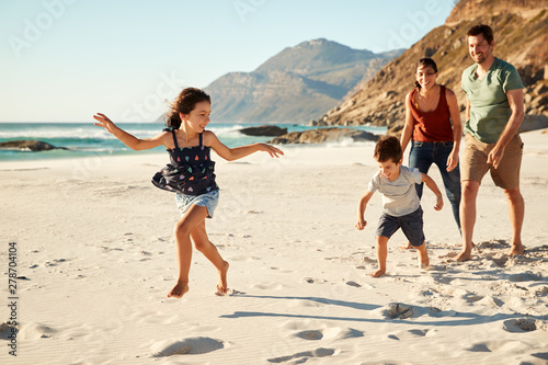 Happy young white family on holiday exploring a beach together, full length #278704104