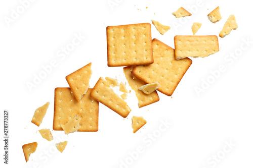 Vászonkép Crushed dry crackers, isolated on white background