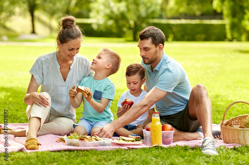Stampa su Tela family, leisure and people concept - happy mother, father and two little sons ha