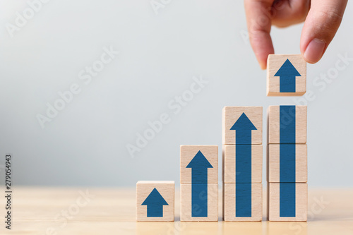 Ladder career path for business growth success process concept.Hand arranging wood block stacking as step stair with arrow up