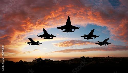 Fotografie, Obraz fighter flying in the sky at sunset