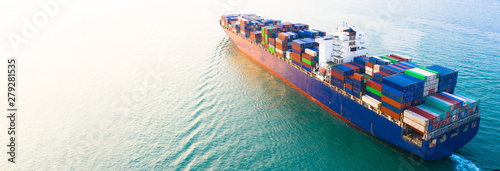 Aerial view container ship carrying container in import export business logistic and transportation of international by container cargo freight ship boat in the open sea, with copy space.