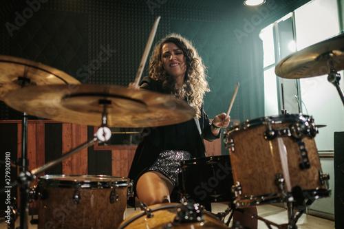 Fényképezés Woman playing drums during music band rehearsal