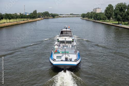 Ship at Dutch Amsterdam Rijn canal sailing near city Utrecht Fototapeta
