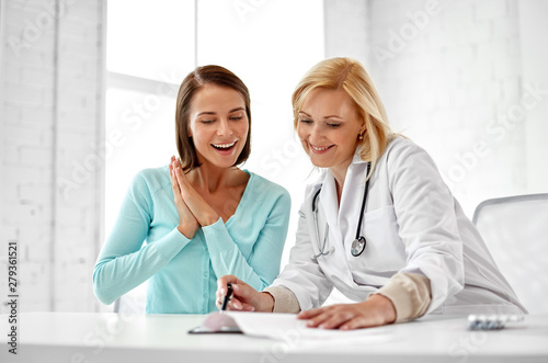 Tablou Canvas medicine, healthcare and people concept - doctor happy woman patient at hospital