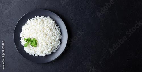 Stampa su Tela Steamed rice on black plate