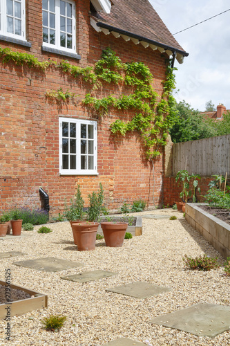 Courtyard garden and house Fototapeta