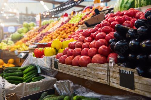 Obraz na plátně Vegetable farmer market counter: colorful various fresh organic healthy vegetables at grocery store