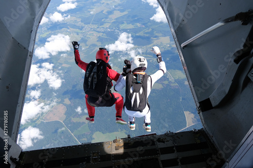 Fototapeta Skydiving. Two skydivers are jumping out of a plane.