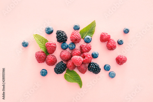 Canvas Print Sweet ripe berries on color background
