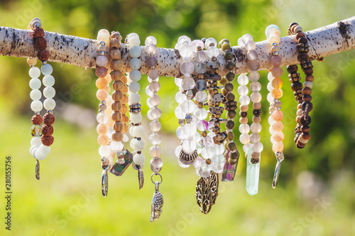 Collection of mineral stone beaded bracelets on natural outdoor background Poster Mural XXL