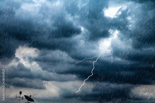 Lightning and thunderstorm flash with raining background Fototapeta