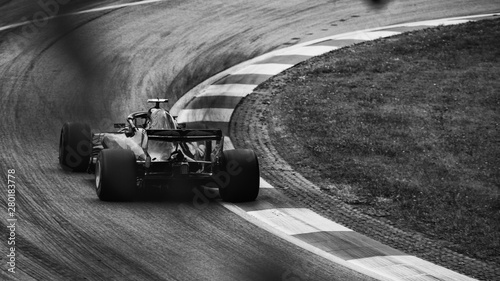 Canvas Print F1 race car on the road, driving into the corner