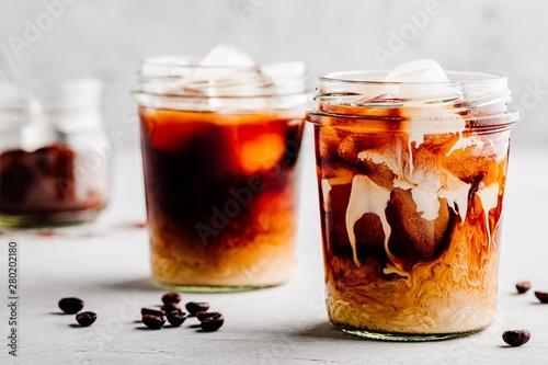Foto Almond Milk Cold Brew Coffee Latte in glass jars