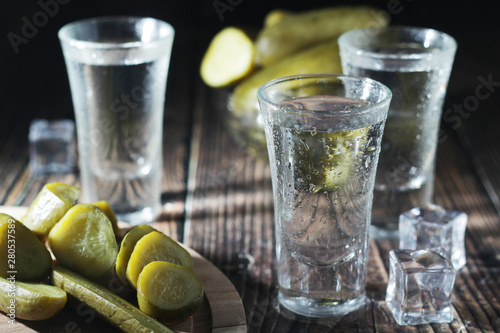 Fotografie, Obraz Three shots with vodka and pickled cucumbers