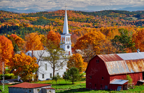 Fotografija Congregational Church and farm with red barn at sunny autumn day in Peacham, Ver