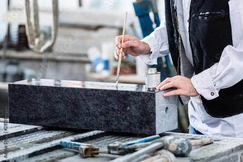 Obraz na plátně Stonemason painting in engraving with silver paint