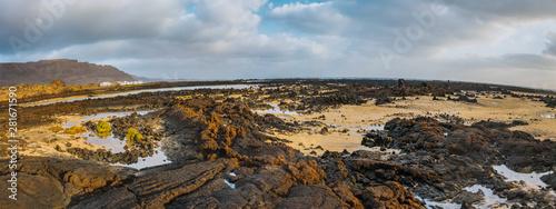 Photo Incredible low tide coastside of Atlantic Ocean Lanzarote Canary Islands Spain
