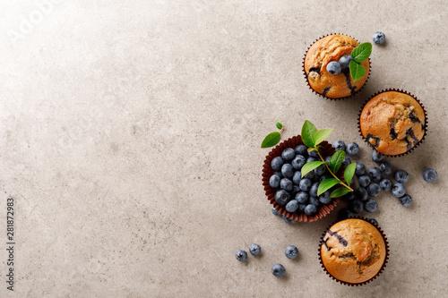 Obraz na płótnie Blueberry muffins with fresh berries, top view