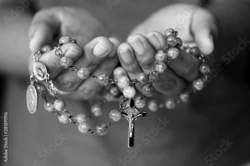 Fototapeta Rosary in hand in black and white