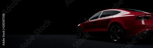 Red sports car on elegant dark background.