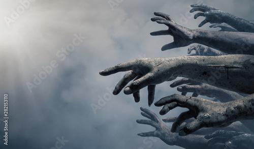 Fényképezés Zombie hands rising in dark Halloween night.
