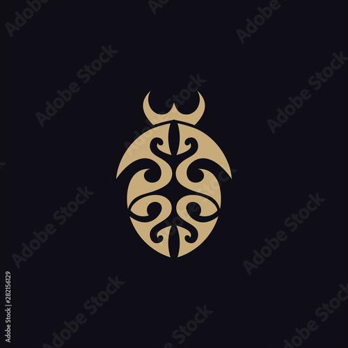 Fototapeta beetle with tribal tattoo logo vector design template