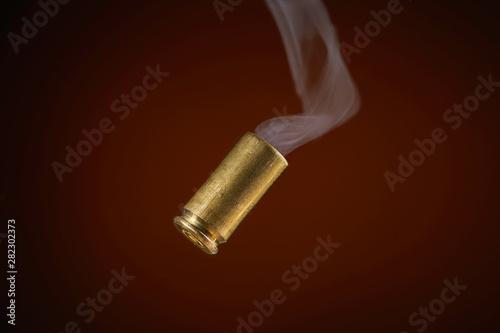 Canvas-taulu smoking bullet casing tumbling