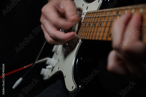 Canvas Print Guitar player on black background