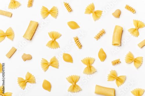 Valokuvatapetti Various uncooked pasta on white background