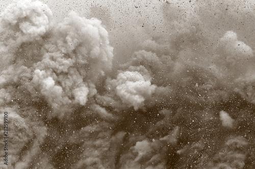 Fototapeta Rock particle and dust clouds after detonator blast