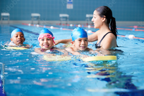 Wallpaper Mural Female Coach In Water Giving Group Of Children Swimming Lesson In Indoor Pool