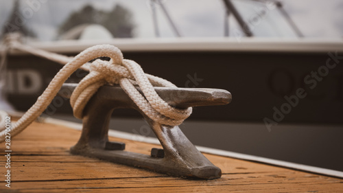 Tela docked boat tied with nautical rope and knot