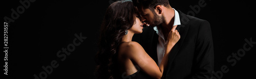 Fotografia, Obraz panoramic shot of girl touching suit of bearded man isolated on black