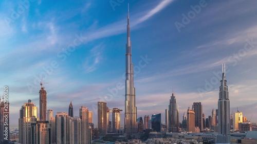Obraz na plátne Dubai Downtown skyline timelapse with Burj Khalifa and other towers during sunri