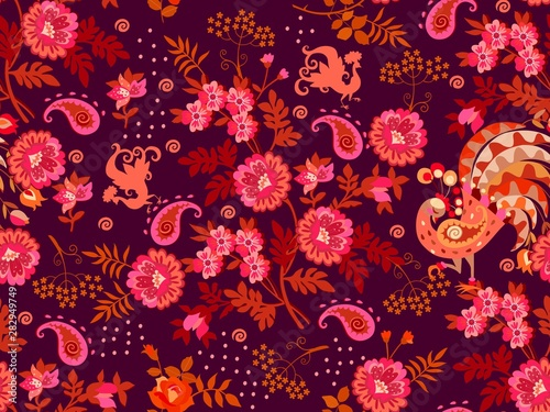 Fototapeta Seamless natural pattern with bouquets of vintage flowers, paisley and silhouettes of fabulous peacocks on dark purple background