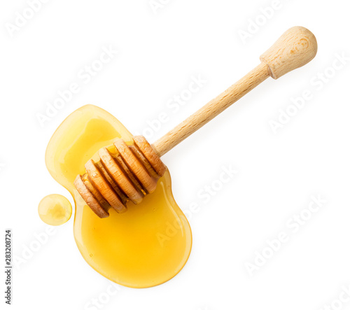 Canvas Print Stick with honey on a white background. The view of the top.