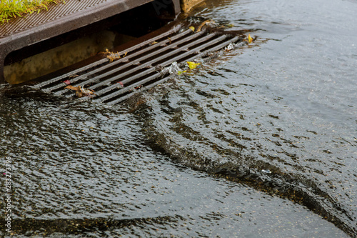 Fotografia Water gushing from storm sewer following very heavy rainfall