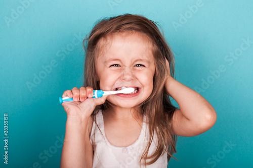 Canvas Print Cute little girl brushing her teeth