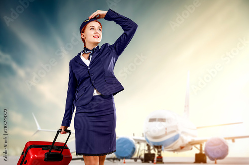 Fotografía Young stewardess and airplane